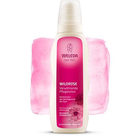 Розовое нежное молочко для тела weleda